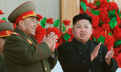 Kim Jong-un (right) with Ri Yong-ho