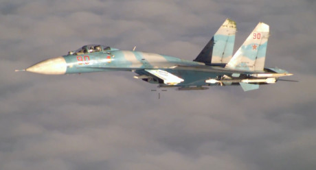 Su-27 intercepting P-3