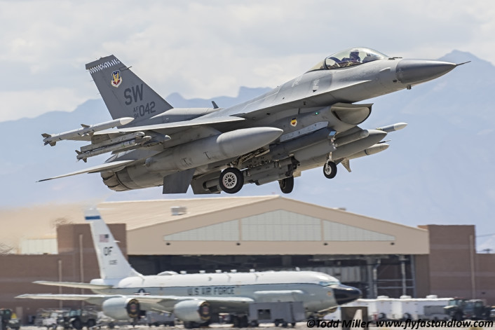 F-16CM 55th FS Shaw AFB departs Nellis on Red Flag 15-3 sortie. RC-135V/W Joint Rivet in background.