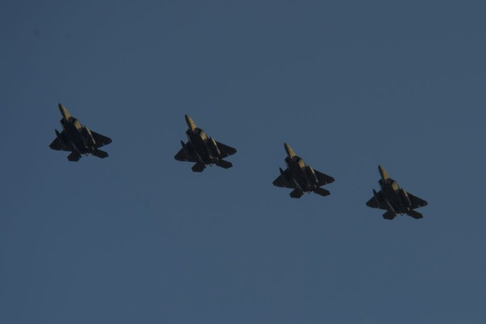 Four F-22 Raptor fighter aircraft assigned to the 95th Fighter Squadron at Tyndall Air Force Base, Fla., fly over the runway before landing at Spangdahlem Air Base, Germany, Aug. 28, 2015. The U.S. Air Force deployed four F-22s, one C-17 Globemaster III and more than 50 Airmen to Spangdahlem in support of the first F-22 European training deployment. The inaugural F-22 training deployment to Europe is funded by the European Reassurance Initiative, a $1 billion pledge announced by President Obama in March 2014. (U.S. Air Force photo by Airman 1st Class Luke Kitterman/Released)