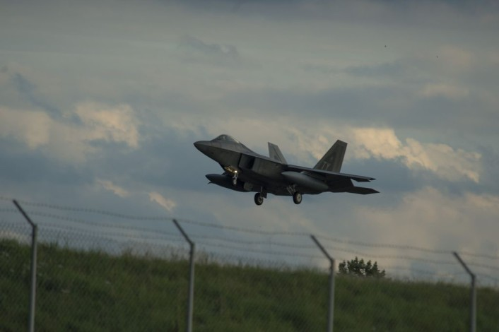 An F-22 Raptor fighter aircraft assigned to the 95th Fighter Squadron at Tyndall Air Force Base, Fla., prepares to land on the runway at Spangdahlem Air Base, Germany, Aug. 28, 2015. The U.S. Air Force deployed four F-22s, one C-17 Globemaster III and more than 50 Airmen to Spangdahlem in support of the first F-22 European training deployment. The inaugural F-22 training deployment to Europe is funded by the European Reassurance Initiative, a $1 billion pledge announced by President Obama in March 2014. (U.S. Air Force photo by Airman 1st Class Luke Kitterman/Released)
