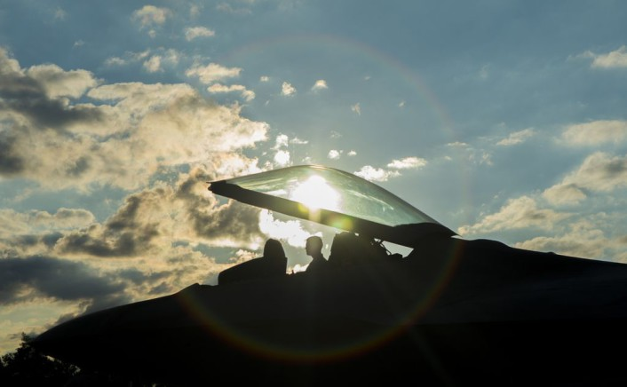 A member of the 95th Fighter Squadron at Tyndall Air Force Base, Fla., sits in the cockpit of an F-22 Raptor fighter aircraft at Spangdahlem Air Base, Germany, Aug. 28, 2015. The U.S. Air Force deployed four F-22 Raptors, one C-17 Globemaster III and more than 50 Airmen to Spangdahlem in support of the first F-22 European training deployment. The inaugural F-22 training deployment to Europe is funded by the European Reassurance Initiative, a $1 billion pledge announced by President Obama in March 2014. (U.S. Air Force photo by Airman 1st Class Luke Kitterman/Released)