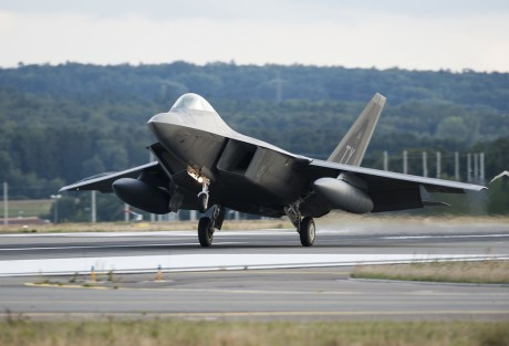 An F-22 Raptor fighter aircraft lands at Spangdahlem Air Base, Germany, Aug. 28, 2015, as part of the inaugural F-22 training deployment to Europe. Four F-22s from the 95th Fighter Squadron at Tyndall Air Force Base, Fla., along with a C-17 Globemaster III cargo aircraft and more than 50 support Airmen were part of the deployment. This effort is part of the European Reassurance Initiative and will serve to assure allies of the Air Force's commitment to European security and stability. (U.S. Air Force photo by Staff Sgt. Chad Warren/Released)
