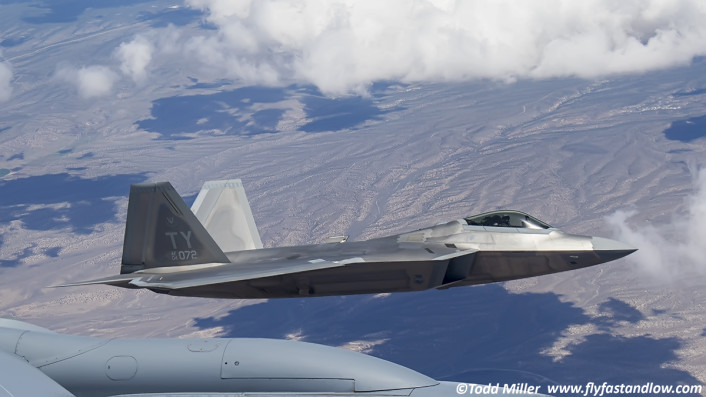 F-22A 325 FW 95 FS from Tyndall AFB just opening refueling doors and getting ready to slide in for fuel.