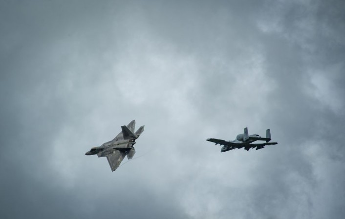 An F-22 Raptor and an A-10 Thunderbolt II fly overhead before landing at Ämari Air Base, Estonia, Sept. 4, 2015, as part of a brief forward deployment. The F-22s have previously deployed to both the Pacific and Southwest Asia for Airmen to train in a realistic environment while testing partner nations' ability to host advanced aircraft like the F-22. The F-22s are deployed from the 95th Fighter Squadron at Tyndall Air Force Base, Florida. The U.S. Air Force routinely deploys aircraft and Airmen to Europe for training and exercises. (U.S. Air Force photo/ Tech. Sgt. Ryan Crane)