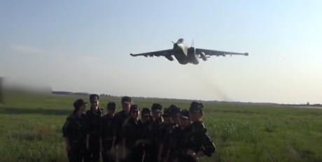 Su-25 over female soldiers