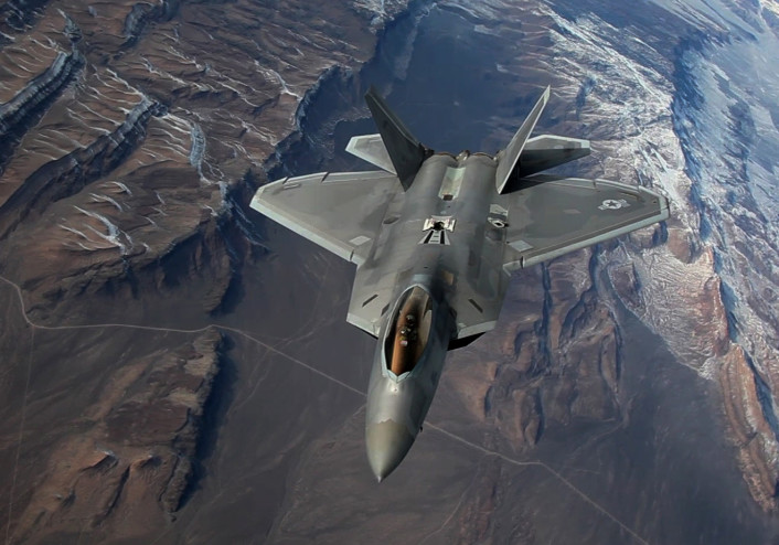 An F-22 Raptor assigned to the 95th Fighter Squadron, Tyndall Air Force Base, Fla., flies a training sortie over the Nevada Test and Training Range Feb. 4, 2016, during Exercise Red Flag 16-1. The full spectrum training Red Flag provides is designed to incorporate multi-domains of warfare to include command and control, real-time intelligence, analysis and exploitation, and electronic warfare. (U.S. Air Force still frame by Master Sgt. Burt Traynor/Released)
