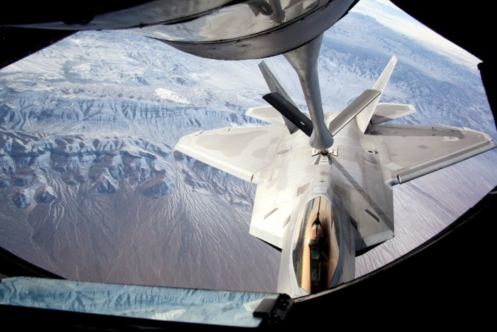 An F-22 Raptor assigned to the 95th Fighter Squadron, Tyndall Air Force Base, Fla., connects to the boom of a KC-135 Stratotanker to refuel during Exercise Red Flag 16-1 Feb. 4, 2016. F-22 Raptors, along with approximately 30 other airframes, are participating in the advanced training program administered by the United States Warfare Center and executed through the 414th Combat Training Squadron, both located at Nellis AFB. (U.S.  Air Force photo by Master Sgt. Burt Traynor/Released)