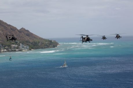 Cool shots show AH-64D Apache Longbow Attack Helicopters flying over Hawaii