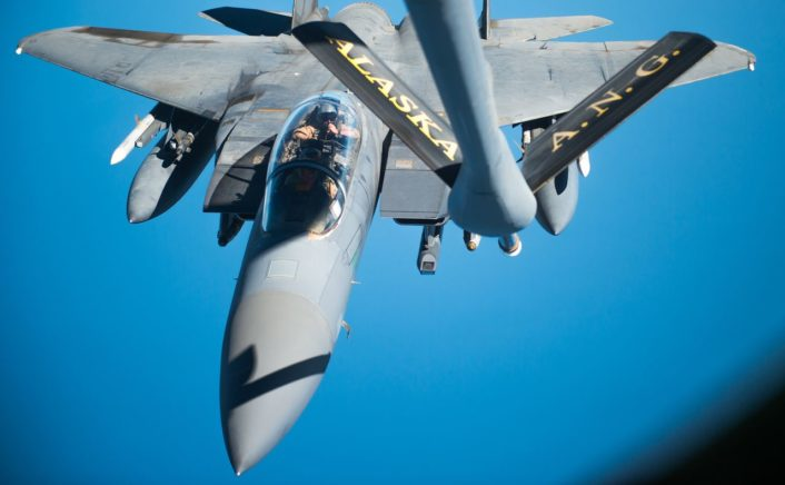 A U.S. Air Force F-15 Strike Eagle approaches a KC-135 Stratotanker over Iraq in support of Operation Inherent Resolve Oct 6, 2016. The KC-135 provides the core aerial refueling capability for the U.S. Air Force and has excelled in this role for more than 50 years. (U.S. Air Force photo by Staff Sgt. Douglas Ellis/Released)