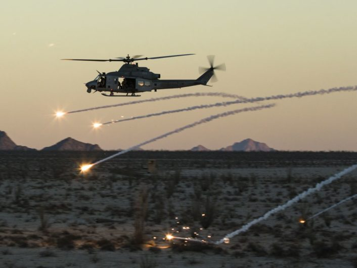 A U.S. Marine Corps UH-1Y Venom assigned to Marine Aviation Weapons and Tactics Squadron One (MAWTS-1) deploys flares during an urban close air support exercise at Yodaville, Yuma, Ariz., Sept. 30, 2016. The urban close air support exercise was part of Weapons and Tactics Instructor Course (WTI) 1-17, a seven-week training event, hosted by MAWTS-1 cadre, which emphasizes operational integration of the six functions of Marine Corps aviation in support of a Marine Air Ground Task Force. MAWTS-1 provides standardized advanced tactical training and certification of unit instructor qualifications to support Marine Aviation Training and Readiness and assists in developing and employing aviation weapons and tactics. (U.S. Marine Corps photo by Lance Cpl. Danny Gonzalez 1st MARDIV COMCAM)